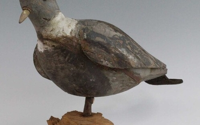 An early 20th century carved and painted pine decoy,...