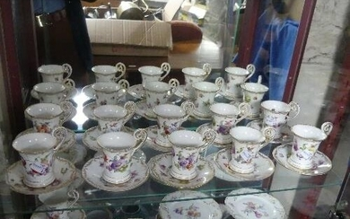 An early 20thC near set of Dresden Coffee Cans and Saucers, ...