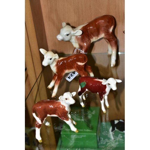FOUR BESWICK HEREFORD CALVES, comprising No 854, brown and w...