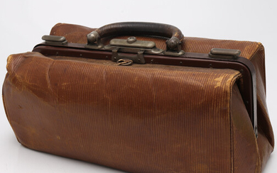 Leather travel briefcase-vanity case, early 20th Century.