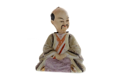 A 20TH CENTURY CHINESE BISCUIT PORCELAIN FIGURE OF A MAN