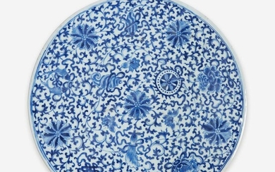 A Chinese blue and white porcelain circular plaque 青花缠枝花卉瓷板