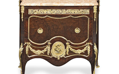 A French early 20th century gilt bronze mounted amboyna and mahogany commode
