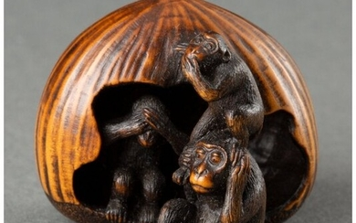 A Japanese Carved Wood Monkeys and Chestnut Nets
