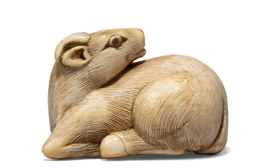 A Japanese ivory netsuke, 19th century, carved as a recumbent ram, with inlaid eyes, overall 4.5cm
