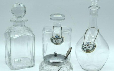 A Kosta Boda glass decanter together with two other