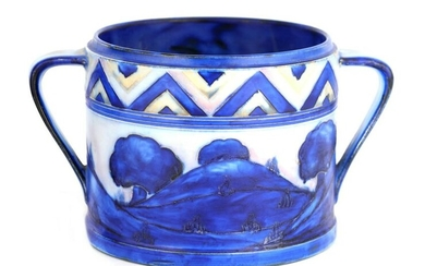 A MOORCROFT TWO HANDLED CYLINDRICAL BISCUIT JAR de