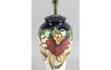 A Moorcroft pottery table lamp, in Anna Lily pattern.