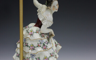 A Thuringian Rudolstadt Volkstedt porcelain figural table lamp, early 20th century, modelled as a ba