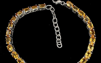 A citrine bracelet set with numerous oval-cut citrines, mounted in rhodium plated sterling silver. Adjustable length 17-20 cm. – Bruun Rasmussen Auctioneers of Fine Art