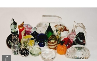 A collection of paperweights of various forms, to include as...