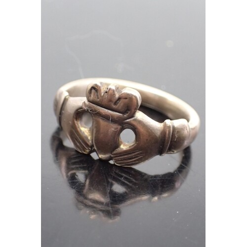 A gold Georgian Claddagh ring, with a Victorian shank finger...