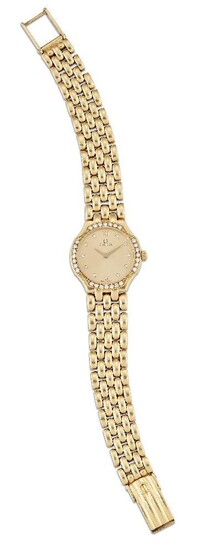 A lady's 18ct gold and diamond quartz wristwatch, by Omega, the champagne dial with diamond dot markers and Roman black numeral at 12, Signed Omega, the bezel set at intervals with seven single-cut diamonds, quartz movement, the case back secured...
