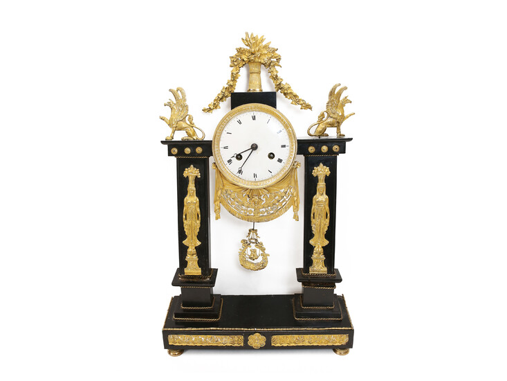 A marble and gilted bronze table clock