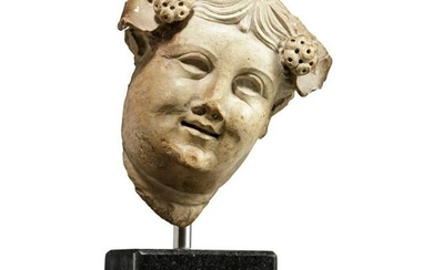 A marble head of Dionysus, Hellenistic - Roman