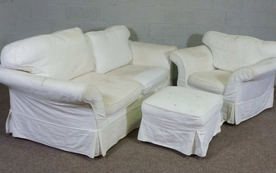 A modern three seater sofa, armchair and ottoman, currently with white linen covers (3)