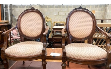 A pair of 19th century French walnut upholstered elbow chair...