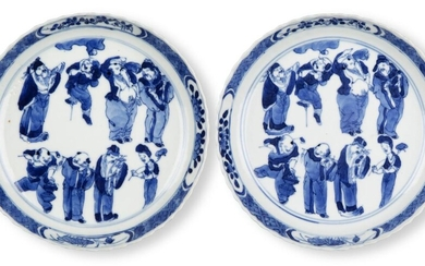 A pair of Chinese porcelain blue and white 'Immortals' saucer dishes, 18th century, each finely painted to the central reserve with the Eight Daoist Immortals inside a border of prunus blossom, underglaze blue four character Kangxi mark inside a...