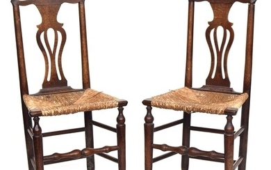 A pair of oak splat back chairs with rush seats
