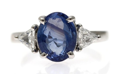 NOT SOLD. A sapphire and diamond ring set with an oval-cut sapphire weighing app. 3.65 ct. flanked by two diamonds, mounted in 14k white gold. Size app. 52. – Bruun Rasmussen Auctioneers of Fine Art