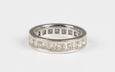 A white gold and diamond full eternity ring, mounted with princess cut diamonds, weight 6g, ring siz