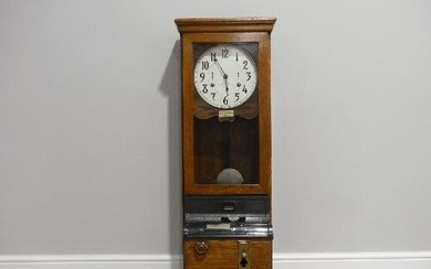 An early 20thC oak cased Clocking-In Machine, c.1930's, of t...