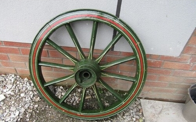 Antique wooden wheel wooden so]pokes with steel tread painte...
