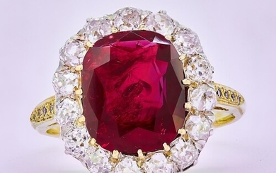 IMPORTANT RUBY AND DIAMOND CLUSTER RING, set with a central ...