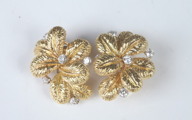 PAIR YELLOW GOLD AND DIAMOND LEAF CLUSTER EARRINGS. Cluster of...