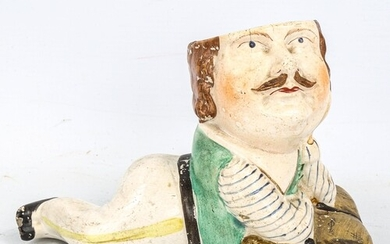 A 19th century Staffordshire Pottery pot in the form of Capt...