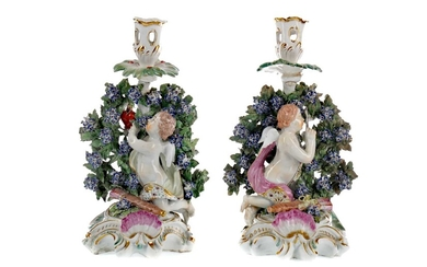 A PAIR OF EARLY 19TH CENTURY ENGLISH PORCELAIN FIGURAL CANDLESTICKS