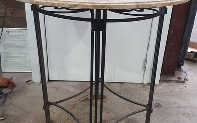 A WROUGHT IRON AND MARBLE TOP CENTRE TABLE