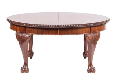 A carved mahogany oval dining table in the George II taste, ...