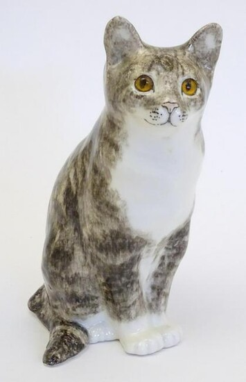 A large Winstanley model of a seated cat. Marked under
