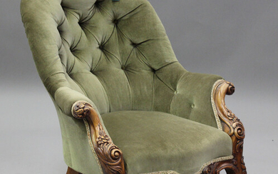 A mid-Victorian walnut tub back armchair, upholstered in buttoned green velour, on carved cabriole l