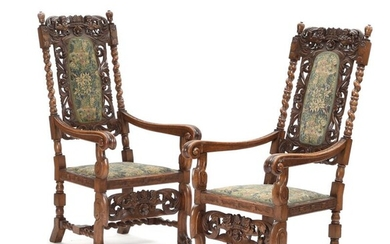 A pair of C. 1900 Baroque style oak armchairs, carved with putti and foliage. (2) – Bruun Rasmussen Auctioneers of Fine Art