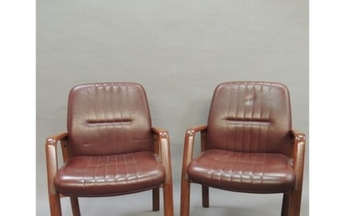 A pair of Italian Vaghi office armchairs, the polished lamin...