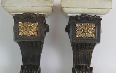 A pair of antique heavy bronze and marble wall corbels, each...