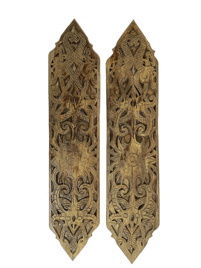 A pair of carved wood tribal style wall ornament