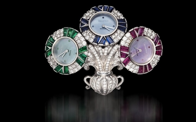 AUDEMARS PIGUET, A UNIQUE GOLD BROOCH WITH 3 QUARTZ WATCHES SET WITH DIAMONDS, RUBIES, SAPPHIRES, AND EMERALDS, ENGRAVED NO. 1