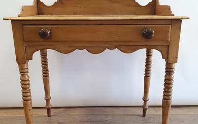 An early 20th century pine side table, with a single frieze ...