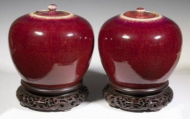 PAIR OF CHINESE QING 19TH C. SANG DE BOEUF COVERED JARS