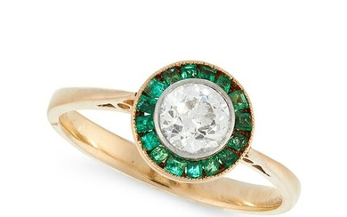 A DIAMOND AND EMERALD DRESS RING in high carat yellow
