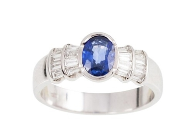 A DIAMOND AND SAPPHIRE DRESS RING, the oval sapphire to bagu...