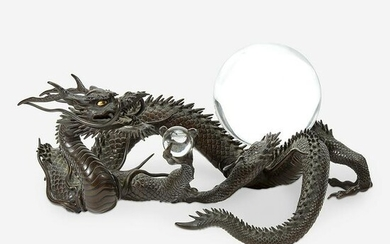 A Japanese patinated bronze dragon and rock crystal