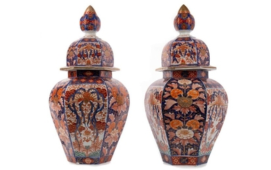A PAIR OF JAPANESE IMARI HEXAGONAL VASES AND COVERS