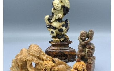 A Pair of Chinese Soapstone Models of Goats with square base...