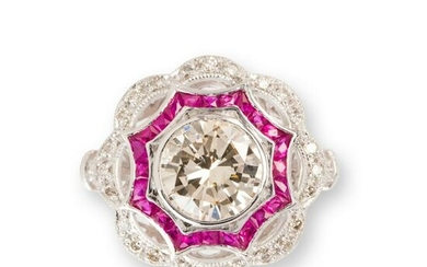 A diamond, ruby and platinum ring