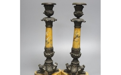 A pair of Empire bronze and Sienna marble candlesticks, heig...