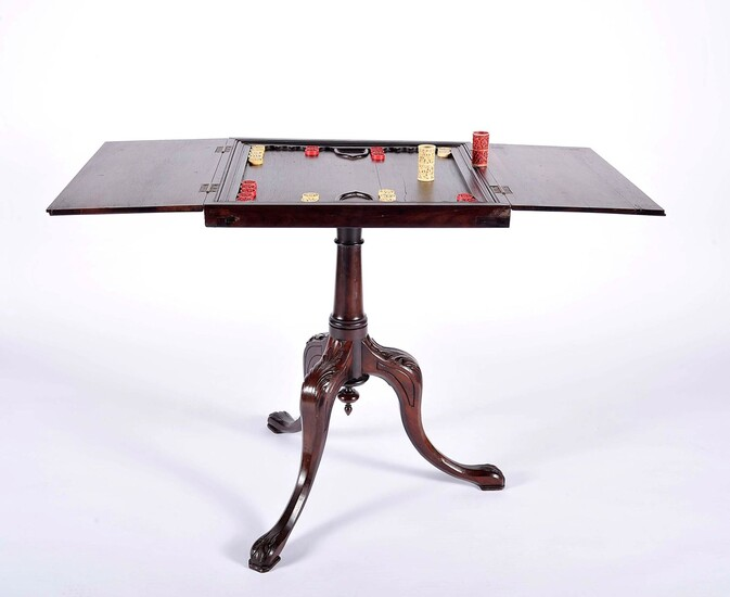 A tripod backgammon table with open top